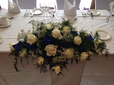 Top table long and low with avalanche roses .