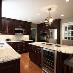 Kitchen Dark Brown Cabinets With White Granite Top Design, Pictures, Remodel, Decor and Ideas