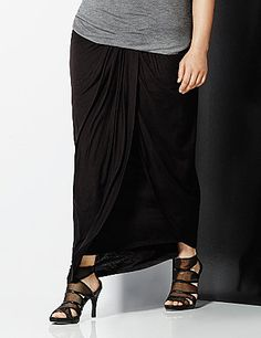 6th & Lane infuses runway attitude into this draped maxi skirt with a graceful, side-swept hem and modern faux leather waist band. #LaneBryant #6THandLANE