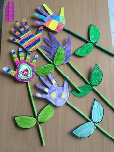 Hand flowers (no instructions--- looks like you draw an outline of a hand, color it, cut it out, and tape it to a straw with paper leaves; maybe that's a green-painted wooden dowel instead of a straw)