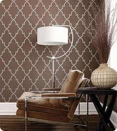 "This Moroccan patterned wallpaper is the perfect compromise between masculine and feminine. The large-scale print and neutral two-tone color scheme keep it from being too ""girly""."