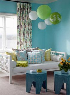 cute little blue stools double for a low table. Love the green and white Chinese lanterns to hang from ceiling!