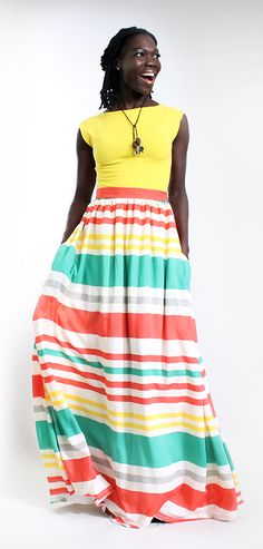 Feel the cobblestone beneath your feet as you float in the Traci Summer  Stripe Maxi Skirt.  This cotton skirt is made with an unbelievably soft vintage hand in a bold bright print. The skirt is fully lined and the side pockets create a sense of care-free whimsy and modern utility. -DIMILOC #summerfashion #summerstyle #summer #fashion #stripes #maxiskirts #maxi #tallfashion #tall #summeroutfits #melanin