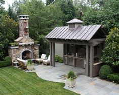 Outdoor kitchen with metal roof. Blue stone patio and huge exterior fireplace. Outdoor kitchen with Outdoor Kitchen Design, Patio Design, Backyard Kitchen, Kitchen Decor, Out Door Kitchen Ideas, Nice Kitchen, Simple Outdoor Kitchen, Garden Design, Kitchen Island