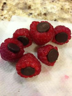 Raspberries with dark chocolate chips. A healthy sweet snack.