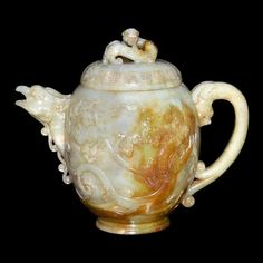 A Superbly Carved Dragon-Phoenix Jade Wine Pot and Cover, Qing Dynasty, Yongzheng Six Character Mark and of the period (1723-1735)