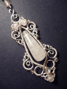 Rose quartz gemstone and silver pendant - wire wrapped jewelry. $32.00, via Etsy.