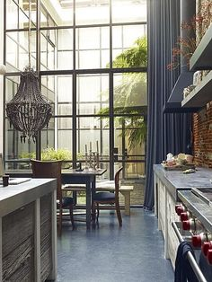 Kitchen: another example of how rustic & sleek can work together. This time we have the fantastic window and the floor that play the modern keys in this interior. The balance here is achieved by combining those two elements with the rustic wooden draws/doors of the kitchen units. The chandelier/light fitting adds that eclectic touch which makes the room very individual...love it!