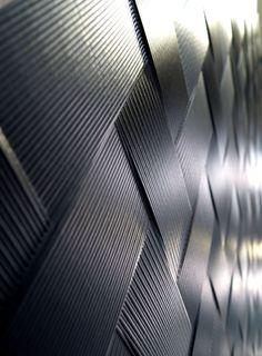 Carbon fiber texture. Polymer concrete panel for Ventilated Façade by ULMA