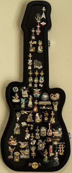 Hard Rock Cafe guitar shaped case. Available at the Hard Rock Cafe online Rock Shop. https://rockshop.hardrock.com/PinsCollectibles/Pin%20Accessories