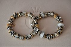 PANDORA. Impressive Two-Tone Bracelet Duo. Beautifully Balanced with Great Choice of Charms Selected......