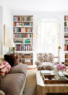 Modern meets classic and traditional in this living room. #books #shelves #couch…