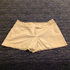 Super Cute White Summer Shorts by Loft Super Cute White Summer Shorts by Loft. Size 4. Has two back pockets, belt loops, zipper front and snap button closure. Two side pickets and cute little front pocket. Super soft. Worn a few times and dry cleaned. LOFT Shorts