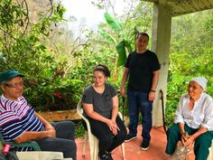 Jesse Vazquez, left, sits with his daughter, Megan, his son, Oscar, and his mother, Mercedes Mercado under the gazebo on their farm in Hatillo, Puerto Rico. Three weeks after Hurricane Maria devastated the island, the family traveled to Hatillo from their home in Bayamon to assess the damage to their property. (Photo: Caitlin Dickson/Yahoo News)