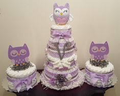 Lavender and grey owl diaper cake with matching centerpieces. Includes 2 receiving blankets, 2 pacifiers, 3 pair of socks, 3 hairbows, initial letter and Personalized owl made by Makaylas Treasures. Visit my Facebook page Simply Showers for more pics and orders. Thank you Kim