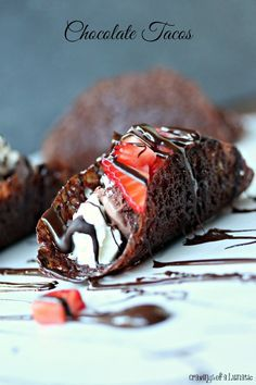 Chocolate Tacos filled with vanilla ice cream, chocolate ice cream, whipped cream and strawberries. I used magnolia lace cookies made with cocoa so they had the crunch of a hard taco.