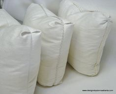 Mock boxed pillows with various corner styles. www.designsbydonnaatlanta.com