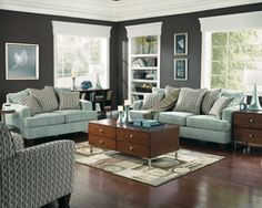 Room with blue couches