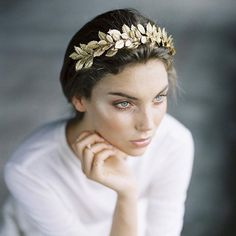 """""""Planning to have an ancient Greek themed wedding? Then this headpiece is definitely for you! Swooning over the elegant leaf-like detail in gold color that…"""""""