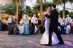 Outdoor reception lighting for destination Florida wedding. Bride and grooms first dance | www.catherineannphotography.com