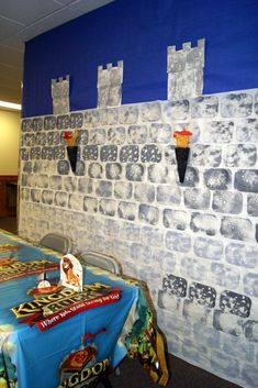 Kingdom Rock VBS Decoration Ideas! Bulletin board paper become castle walls.