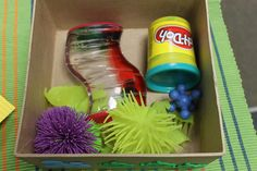 A box filled with items preferred by the child that provide sensory input or calming effect