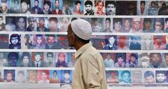 A relative of a disappeared Kashmiri youth looks at the photographs of missing people during a demonstration organized by the Association of Parents of Disappeared Persons, a prominent local rights group, in Srinagar on July 10, 2011. Human rights workers have complained for years that innocent people have disappeared, been killed by government forces in staged gun battles, and suspected rebels arrested and never heard from again. (Mukhtar Khan/AP)