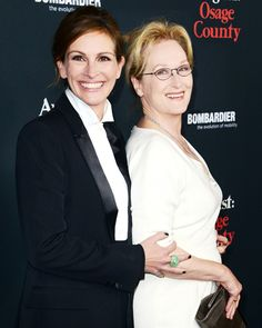 Julia Roberts and Meryl Streep were all smiles at the premiere of 'August: Osage County' at Regal Cinemas in Los Angeles. Roberts (in Givenchy) and Streep (in Gucci) star in the movie adaptation of Tracy Letts' play opposite of Juliette Lewis, Julianne Nicholson, and more.