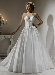 Fabric:Taffeta Embellishment:Beaded Silhouette: Ball Gown Straps: Halter Top Sleeves:Sleeveless Neckline: Halter Top  Back:Lace up Hemline:Floor-length Train:Court Train PHOTOGRAPHED IN: Ivory $239.99