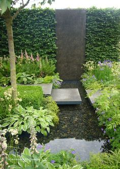 "Outside of the master bathroom french doors - break in the hedge with metal is interesting.  Like the pool with rock.  However, surroundings not so much.  Would want something more with our Hollywood ""Mediterranean"" theme with an Asian flare - like a buddha emerging from the water...formal hardscape too, marble..."