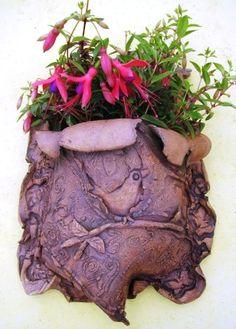 Ceramic wall hanging pot...