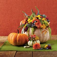 Instead of cutting a whole in the pumpkin secure some floral foam on the top using the stem to hold it in place or ribbon wrapped around the pumpkin then make your arrangement.  When it's time to trash the pumpkin remove the arrangement & save for the following year.  Saves time the next year & your pumpkin will last longer.