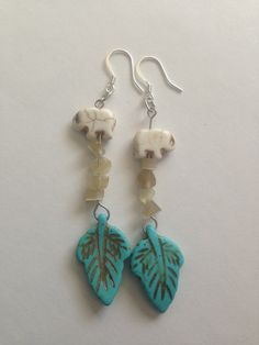 Turquoise Leaf and Elephant Earrings by AllaLunaDesign on Etsy