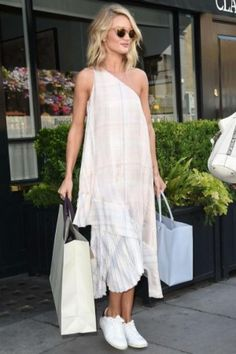 Rosie Huntington-Whiteley wearing Isabel Marant Etoile Bart Leather Sneakers, Stella McCartney Rosa Printed Silk Dress, Cartier Love Bracelet in Rose Gold, Balenciaga Papier A4 Tote, Anita Ko Floating 18-Karat Rose Gold Diamond Necklace and Dolce & Gabbana Marble-Effect Round-Framed Sunglasses