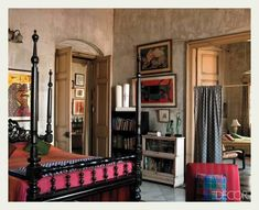 An Indian Summer: A home in Calcutta.  Wonderful color pops against a lovely neutral background.  Books and artwork add comfort and originality.