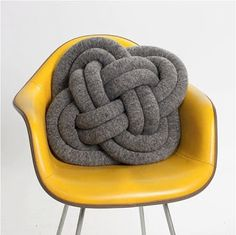 """Knot pillow!      Tutorial removed from site, but with ~3/4 yds of fabric, create two tubes from 6"""" strips about 100-120"""" long and stuff.  Simultaneously knot both tubes halfway and connect ends.  Knot pictured is the Carrick Bend, tutorial available on the link for the celtic knot."""