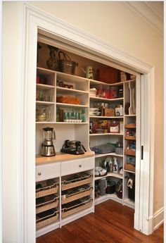 pantry with pocket doors and coffee and toaster station... this makes me want plug ins in my pantry