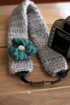 I've never seen a crochet camera strap!  so cute. No pattern.  I wonder if I could figure it out?