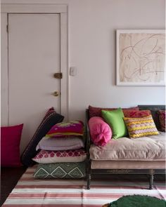 Ethnic colourful cushions on neutral sofa,just perfect