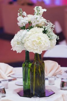 White Hydrangea in Wine Bottle Centerpieces   Horn Photography And Design https://www.theknot.com/marketplace/horn-photography-and-design-dahlonega-ga-536871