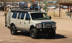 Sportsmobile Ford E-350 Camper Van loaded with Aluminess gear! Front and rear bumper, roof rack, ladder, expedition kit and nerf bars.