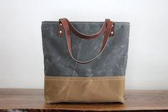 Waxed Canvas Tote Bag No. 8 with Genuine by MountainHomeGoods.   If the other bag isn't available, I like this one too!