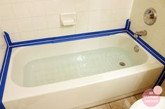 how to re caulk a bathtub tips, bathroom ideas, home maintenance repairs, how to Use paint tape to keep caulk from getting wide. fill tub to add weight while drying.