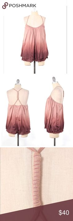 Akemi + Kin dip-dyed knit trapeze tank Soft jersey tank from Anthropologie brand, Akemi + Kin. Rose pink ombré that fades into a dark pink/purple tone.Accordion pleated jersey; layered. Racerback with a twisted strap at the back neckline. Trapeze, flowy fit that is loose through the waist. Size S, can probably fit a M as well since it is oversized. Anthropologie Tops Tank Tops