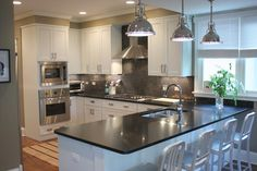 White Shaker Cabinets With Hickory Hardware Studio Collection Pulls.