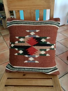 A personal favorite from my Etsy shop https://www.etsy.com/listing/264899354/mexican-zapotec-woven-wool-pillow