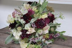 mix of textures scabious, poppy seedheads, love in a mist seedheads and flowers, veronica, ammi majus and thyme.. mix in dahlias or brassica too