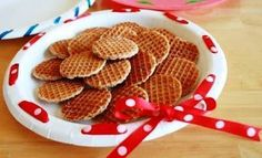 Cookie gift giving - Spruce up a paper plate by punching holes in the rim with a hole punch. Then weave ribbon in and out of the holes to embellish the edge.