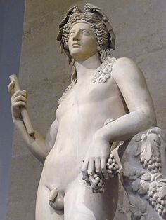 Detail. Statue of Dionysus. Marble, 2nd century CE (arms and legs were heavily restored in the 18th century), found in Italy. Department of Greek, Etruscan and Roman antiquities, Denon, ground floor, room A. Louvre Museum.