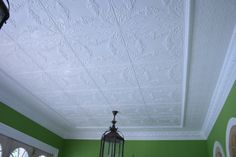 Pressed Metal Ceiling with Flannel Flower as the central panel, Savannah as the border and Egg and Darte cornice.